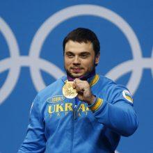 Ukrainos sunkiaatletis O. Torochtijus dėl dopingo prarado olimpinį aukso medalį