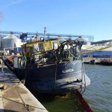 Klaipėdos uoste galiausiai iškelta nuskendusi žemkasė