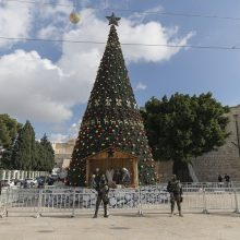 Kalėdų džiaugsmą temdo pandemijos šešėlis: kaip švenčia pasaulio gyventojai?