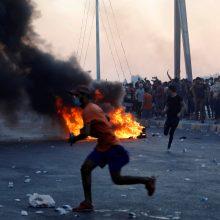 Protestai Irake pareikalavo 157 gyvybių