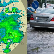 Sostinę semia gausus lietus: kai kurios gatvės – sunkiai pravažiuojamos