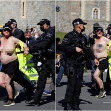 Princo Philipo laidotuvės neapsiėjo be incidentų: pareigūnams teko tramdyti pusnuogę moterį