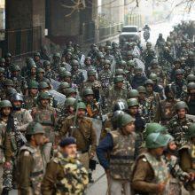 Delyje riaušių aukų skaičiui išaugus iki 27, N. Modi paragino laikytis rimties